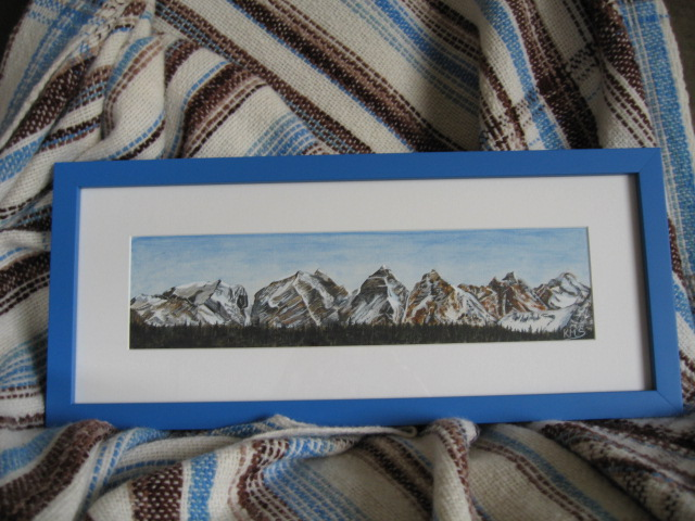 Painting of Seven Sisters Mountains and woven blanket